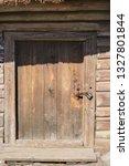 the wooden door in the old... | Shutterstock . vector #1327801844