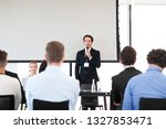 speaker at business conference... | Shutterstock . vector #1327853471