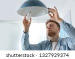 Man Changing Light Bulb In...