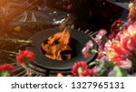 may 9  eternal fire and flowers....   Shutterstock . vector #1327965131