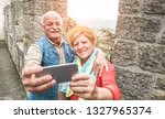 senior couple taking a selfie... | Shutterstock . vector #1327965374