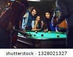 friends play billiards. | Shutterstock . vector #1328021327