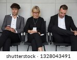 people sitting waiting for a... | Shutterstock . vector #1328043491