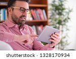 relaxed young man browsing the... | Shutterstock . vector #1328170934
