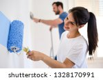 happy couple painting walls in... | Shutterstock . vector #1328170991