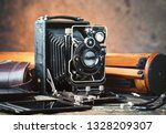 old photo devices on the old... | Shutterstock . vector #1328209307