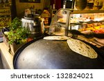 lebanese bread on the hot saj   ... | Shutterstock . vector #132824021