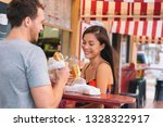 happy couple eating sandwiches... | Shutterstock . vector #1328322917