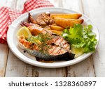 grilled salmon steak  a portion ... | Shutterstock . vector #1328360897