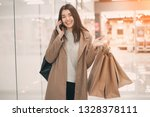 young woman with shopping bags... | Shutterstock . vector #1328378111