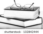 a pile of books and glasses... | Shutterstock . vector #132842444