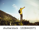 senior man standing on a hill... | Shutterstock . vector #1328442071