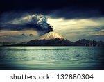 erupting volcano near water  ... | Shutterstock . vector #132880304