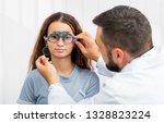 doctor holding special eye... | Shutterstock . vector #1328823224