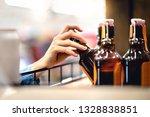 Hand Taking Bottle Of Beer Fro...