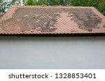 aged shingles roof of barn.... | Shutterstock . vector #1328853401