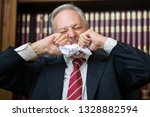 angry businessman eating a... | Shutterstock . vector #1328882594