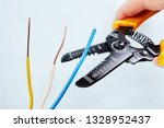 electrician uses the wire... | Shutterstock . vector #1328952437
