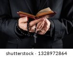 Hands Of A Christian Priest...