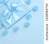 springtime decorated blue gift... | Shutterstock . vector #1328983754