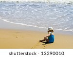 Little baby on the beach - stock photo