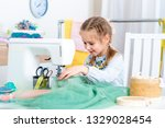 little girl using sewing... | Shutterstock . vector #1329028454