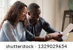 happy mixed race couple... | Shutterstock . vector #1329029654