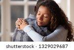 happy mixed race woman hug... | Shutterstock . vector #1329029687