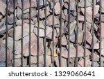 gabion from vertical metal rods ... | Shutterstock . vector #1329060641