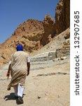 Man in Chebica oasis in Tunisia - stock photo