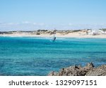 solitary windsurfer sailing in... | Shutterstock . vector #1329097151