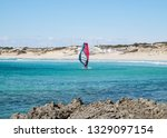 solitary windsurfer sailing in... | Shutterstock . vector #1329097154