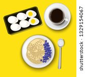 oatmeal in a bowl with... | Shutterstock .eps vector #1329154067
