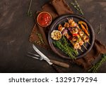 grilled chicken skewers with... | Shutterstock . vector #1329179294