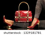 stylish red bag hanging on a... | Shutterstock . vector #1329181781
