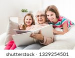 grandmother with granddaughters ... | Shutterstock . vector #1329254501