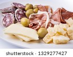 antipasti. cold meat and cheese ... | Shutterstock . vector #1329277427