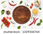 round cutting board with pizza... | Shutterstock . vector #1329336764