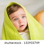 Portrait Of A Cute Baby With Towel On Head, Indoors - stock photo