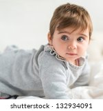 Portrait Of Cute Baby, Indoors - stock photo