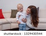 cute mom wants to cheer up her... | Shutterstock . vector #1329430544