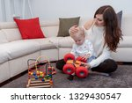 cute mom and her toddler son... | Shutterstock . vector #1329430547
