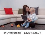 cute mom and her toddler son... | Shutterstock . vector #1329432674