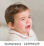 Portrait Of Baby Boy Crying, Indoors - stock photo