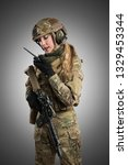 female soldier in tactical... | Shutterstock . vector #1329453344