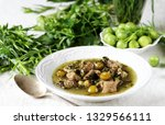 green plum  with meat stew and... | Shutterstock . vector #1329566111