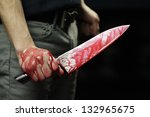 Man Holding Knife With Blood...