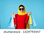 arab woman joyful with packages ...   Shutterstock . vector #1329793547