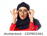 surprised arab woman with... | Shutterstock . vector #1329831461