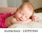 a newborn baby sleeping on a... | Shutterstock . vector #132991964